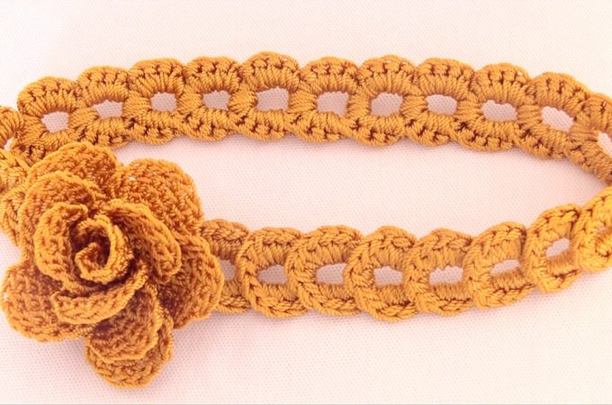 Crochet Flower Headband Featured Image - This tutorial covers how to create a beautiful crochet flower headband of braided rings. Making this seemingly complicated headband is actually very simple.